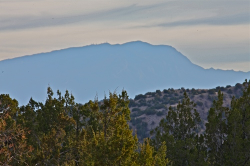 You can see the Sandia Mountains from the foot of the trail.